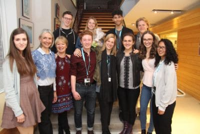 Tutor Group standing on staircase smiling