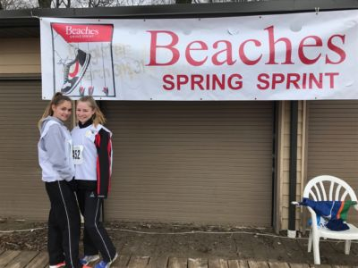 Tutors posing with the spring sprint banner