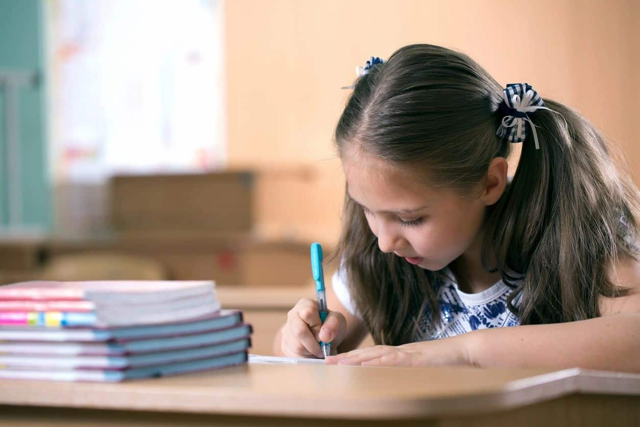 child studying and completing homework